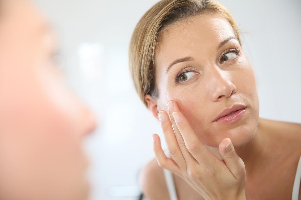 Girl checking her skin